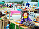 Flea Market with tables of clown marionette and dishware