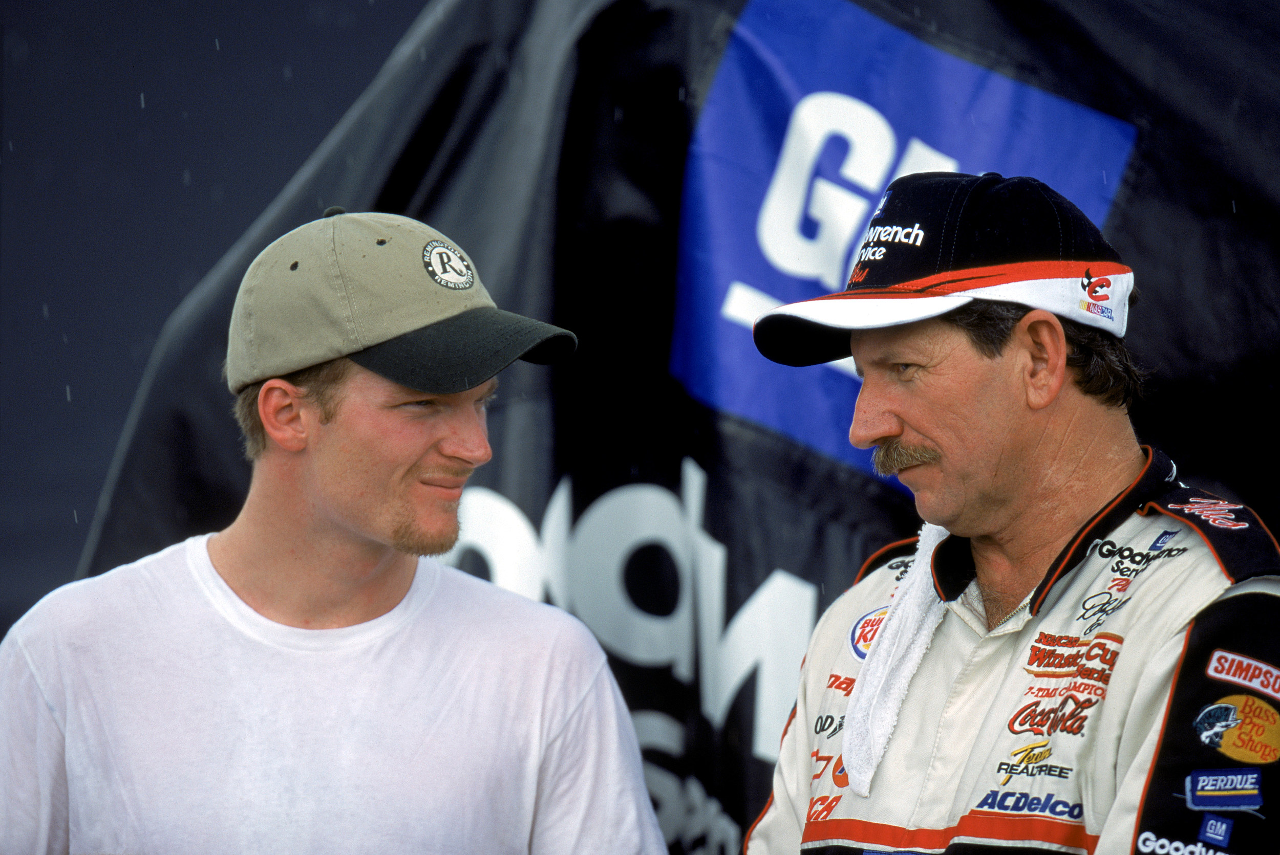 Earnhardts Jr. and Sr. pose for a photograph
