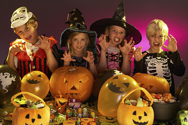 Halloween party with children wearing costumes